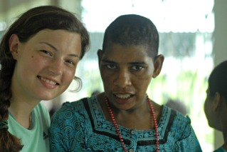 Volunteer Emily and a resident at Shanti Dan.