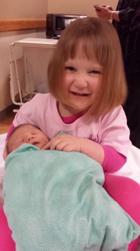 Big sister Ruthie meeting her baby brother for the first time.